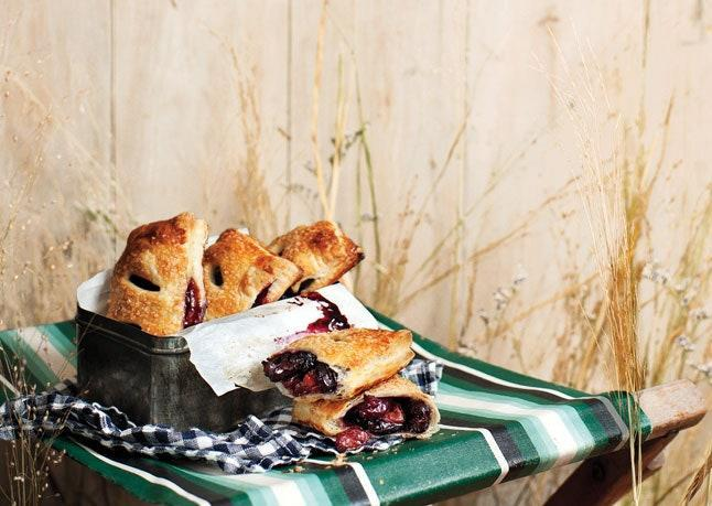 """A mixture of fresh and dried cherries brings the sweetness in these must-have treats. <a href=""""https://www.bonappetit.com/recipe/cherry-hand-pies?mbid=synd_yahoo_rss"""" rel=""""nofollow noopener"""" target=""""_blank"""" data-ylk=""""slk:See recipe."""" class=""""link rapid-noclick-resp"""">See recipe.</a>"""