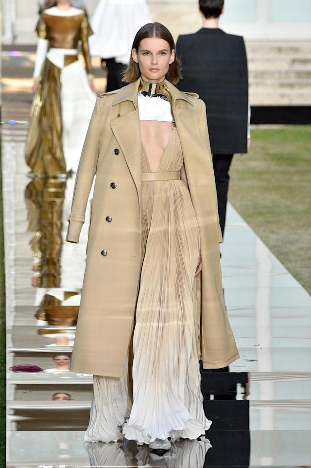 <p>Model wears a light beige ombré pleated gown with matching trench coat and metal choker from the Givenchy fall 2018 couture collection. (Photo: Getty Images) </p>