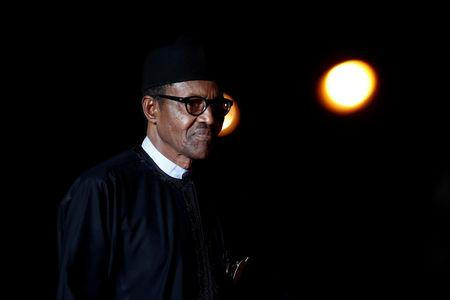FILE PHOTO: Nigeria's President Muhammadu Buhari arrives to attend a visit and a dinner at the Orsay Museum in Paris