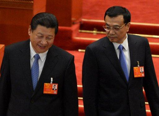 China's Xi Jinping (left) and Li Keqiang at the 12th National People's Congress (NPC) in Beijing, on March 16, 2013