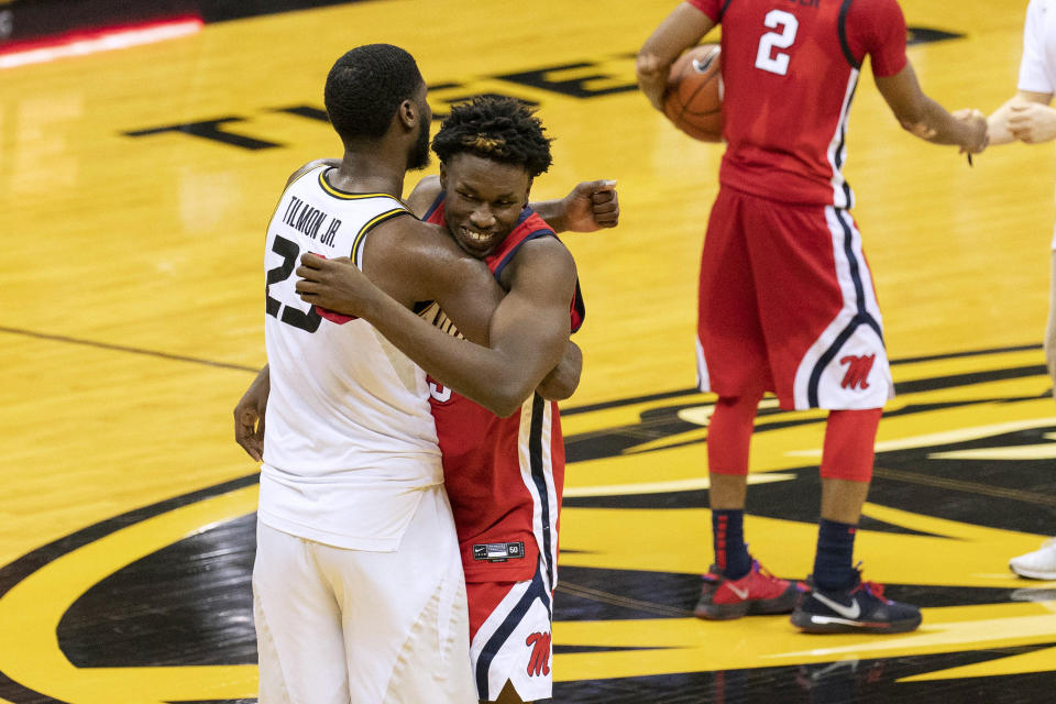 Missouri's Jeremiah Tilmon, left, and Mississippi's Sammy Hunter, right, embrace after Mississippi won the NCAA college basketball game Tuesday, Feb. 23, 2021, in Columbia, Mo. (AP Photo/L.G. Patterson)
