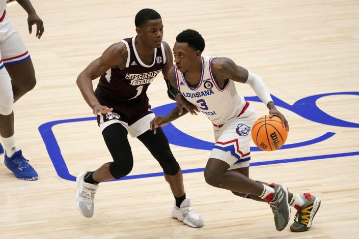 Mississippi State guard Iverson Molinar (1) defends as Louisiana Tech guard Amorie Archibald (3) handles the ball in the second half of an NCAA college basketball game in the semifinals of the NIT, Saturday, March 27, 2021, in Frisco, Texas. (AP Photo/Tony Gutierrez)