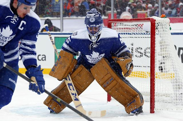 Toronto Maple Leafs goalie Jonathan Bernier (45) guards the net during the second period of the Winter Classic outdoor NHL hockey game against the Detroit Red Wings at Michigan Stadium in Ann Arbor, Mich., Wednesday, Jan. 1, 2014. (AP Photo/Paul Sancya)