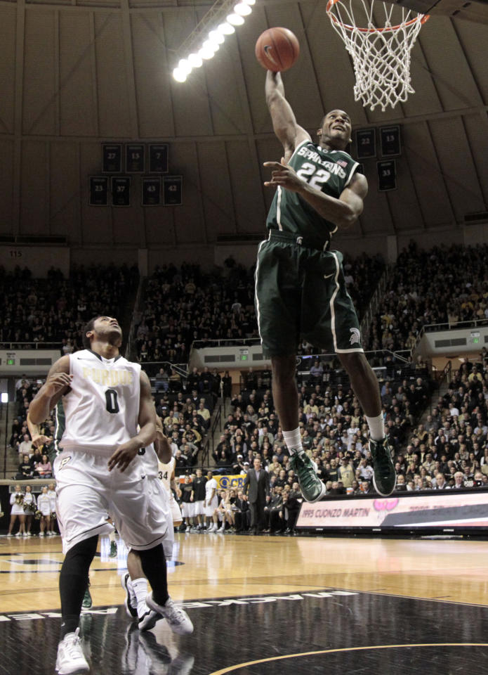 Michigan State guard Branden Dawson, right, dunks in front of Purdue guard Terone Johnson in the second half of an NCAA college basketball game in West Lafayette, Ind. Sunday, Feb. 19, 2012. Michigan State won 76-62. (AP Photo/AJ Mast)