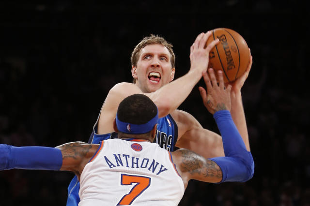 Dallas Mavericks' Dirk Nowitzki works to get open before shooting the game-winning basket against New York Knicks' Carmelo Anthony (7) in the final seconds of an NBA basketball game Monday, Feb. 24, 2014, in New York. Dallas won 110-108. (AP Photo/Jason DeCrow)