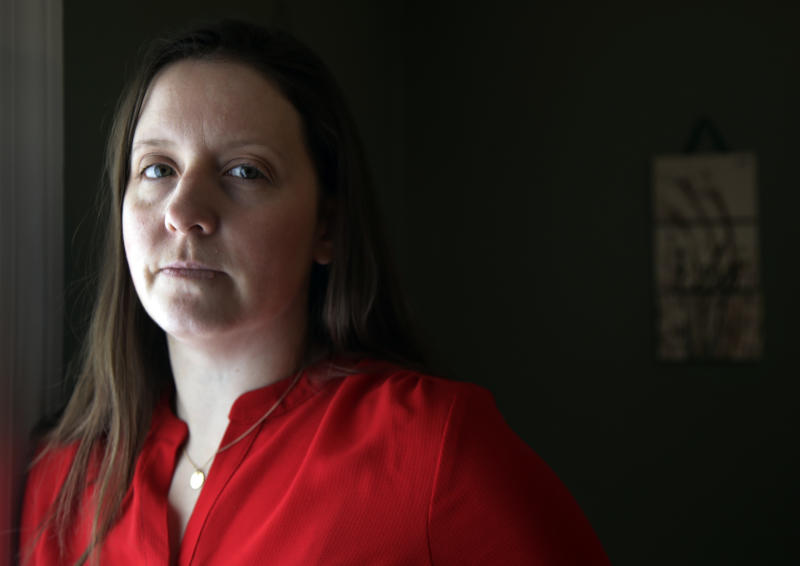 In this Feb. 26, 2019, photo, Stephanie Clark, executive director at Amirah, poses for a photo, in Wakefield, Mass. Amirah is an organization that works to provide safe spaces for victims and survivors of sex trafficking in New England, where illegal massage parlors have proliferated. (AP Photo/Elise Amendola)