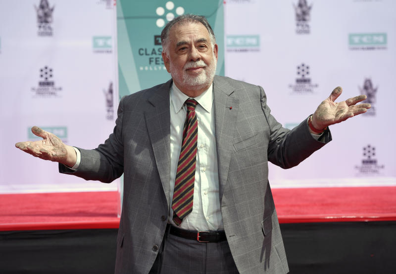 Francis Ford Coppola shows off his hands after placing them in cement during a handprint and footprint ceremony at the TCL Chinese Theater on Friday, April 29, 2016, in Los Angeles. (Photo by Chris Pizzello/Invision/AP)