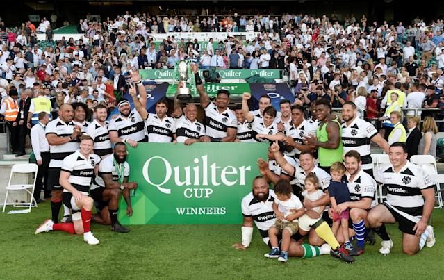 Rugby Union - England v Barbarians, Twickenham Stadium, London, Britain - May 27, 2018 Barbarians players celebrate with the trophy after victory Action Images via Reuters/Tony O'Brien