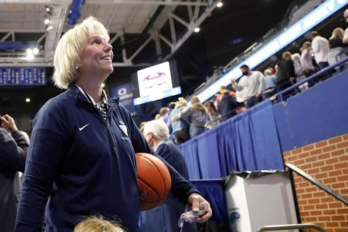 "Sacred Heart head coach Donna Moir looks to the crowd after the Valkyries' 49-47 victory. ""I just never thought that we'd be back here, because I've had some good teams and had a lot of bad luck."""
