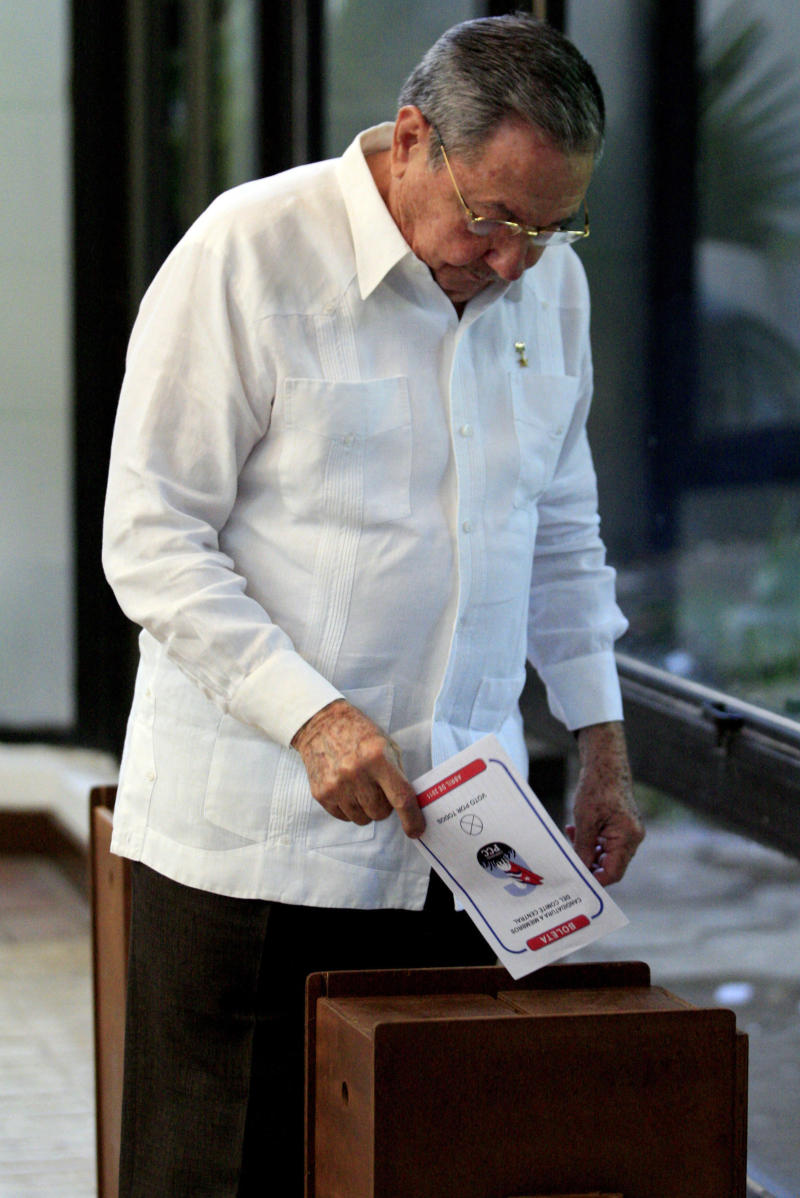 Cuba's President Raul Castro casts his vote to elect the new Cuba's Communist Party Central Committee during  a 6th Congress of the Cuban Communist Party session  in Havana, Cuba, Monday, April 18, 2011. A new generation of leaders must act decisively and without hesitation to correct the errors of the past and lead the island once those who fought in the 1959 revolution are gone, Cuba's leader Fidel Castro said in a column published Monday. (AP Photo/Ismael Francisco, Prensa Latina)