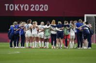 Britain players celebrate at the end of women's soccer match against Japan at the 2020 Summer Olympics, Saturday, July 24, 2021, in Sapporo, Japan. Britain won 1-0. (AP Photo/Silvia Izquierdo)
