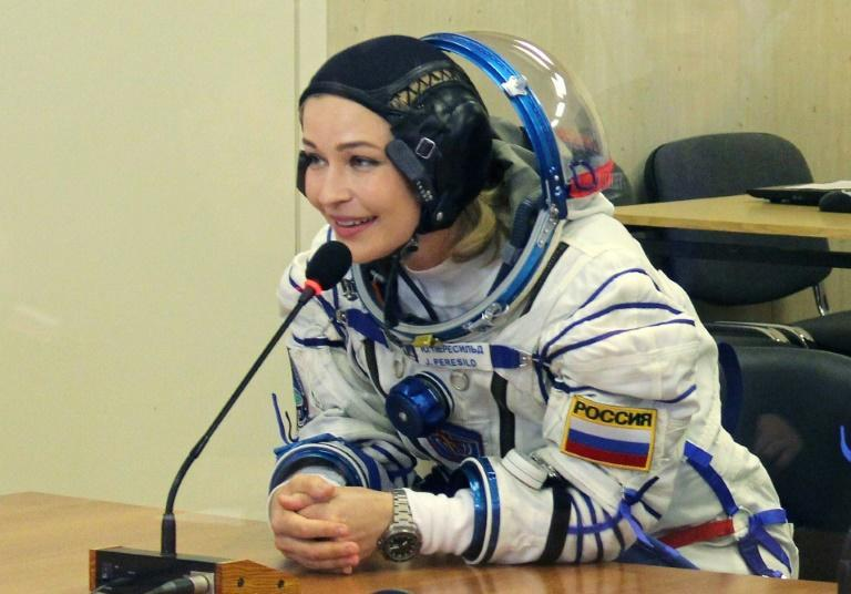 Actress Yulia Peresild, 37, and film director Klim Shipenko, 38, took off from the Russia-leased Baikonur Cosmodrome in ex-Soviet Kazakhstan (AFP/-)