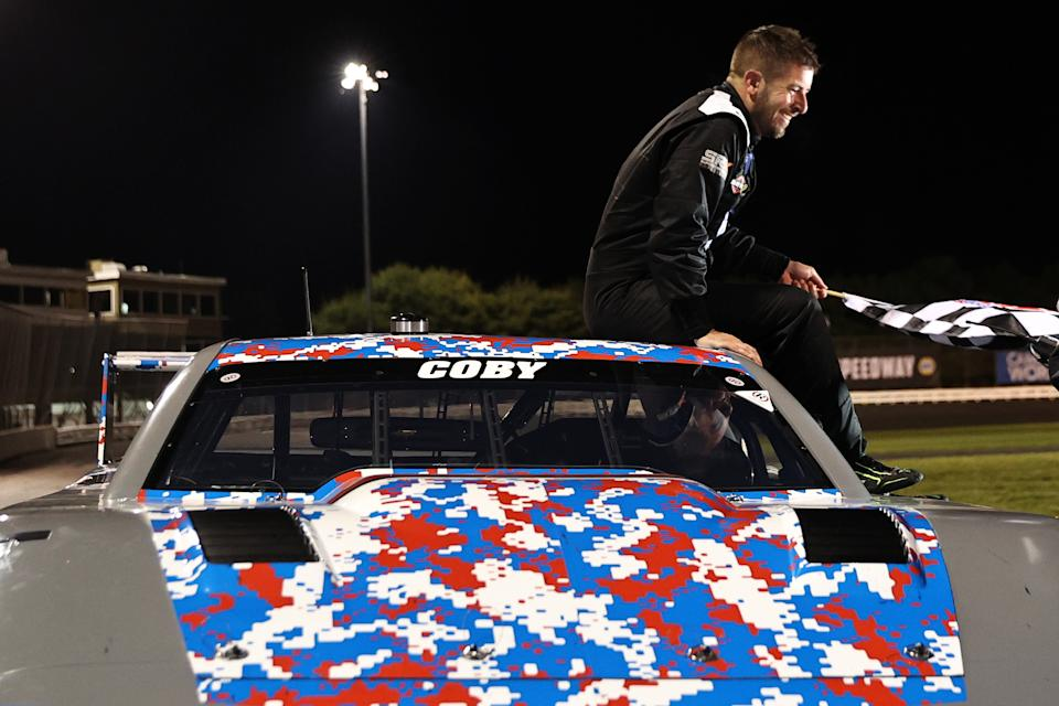 STAFFORD SPRINGS, CONNECTICUT - JUNE 12: SRX driver Doug Coby celebrates after winning the Inaugural Superstar Racing Experience Event at Stafford Motor Speedway on June 12, 2021 in Stafford Springs, Connecticut. (Photo by Elsa/SRX/Getty Images)