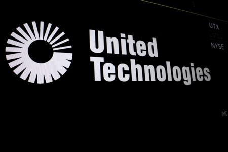 FILE PHOTO: United Technologies logo is displayed on a screen at the post where it's stock is traded on the floor of the NYSE in New York