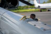 The mark of a projectile impact is seen on a helicopter that Colombian President Ivan Duque was traveling in, after it suffered an attack during an overflight, according to authorities, in Cucuta