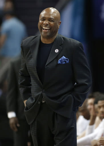 Florida State head coach Leonard Hamilton laughs at a joke from Virginia Tech head coach Buzz Williams, not shown, during the first half of an NCAA college basketball game in the Atlantic Coast Conference tournament in Charlotte, N.C., Thursday, March 14, 2019. (AP Photo/Nell Redmond)