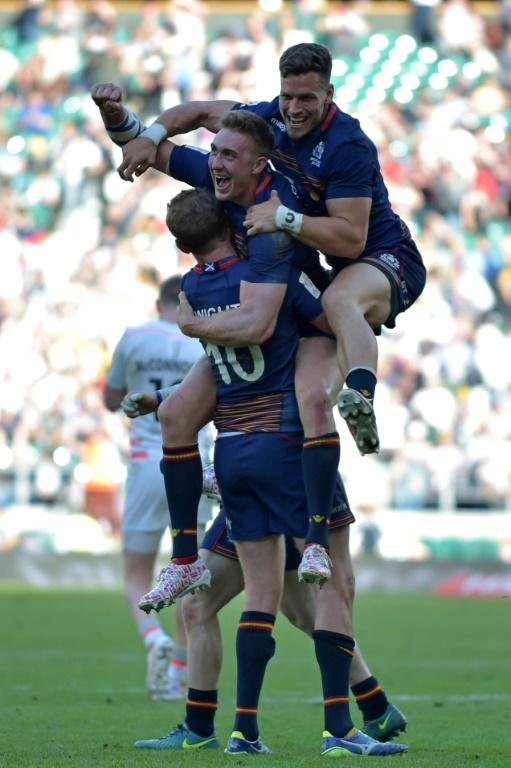 Scotland players celebrate on the pitch after their victory in the cup final match of the World Rugby Sevens Series - London on May 21, 2017