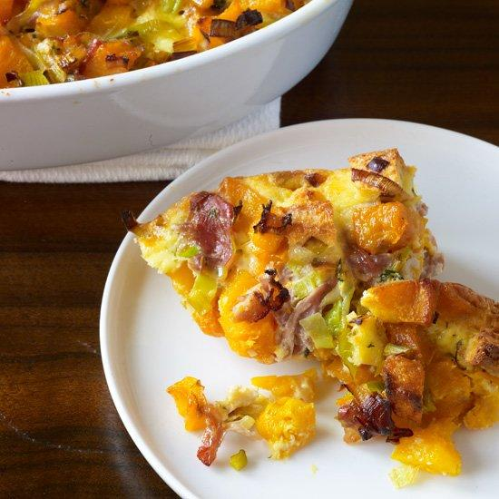 "<p>This luscious squash-studded bread pudding is the ideal accompaniment to roasted meats and birds, or cut it into large squares and serve as a main course with a green salad on the side.</p><p><a href=""https://www.foodandwine.com/recipes/butternut-squash-casserole-with-leeks-prosciutto-and-thyme"">GO TO RECIPE</a></p>"
