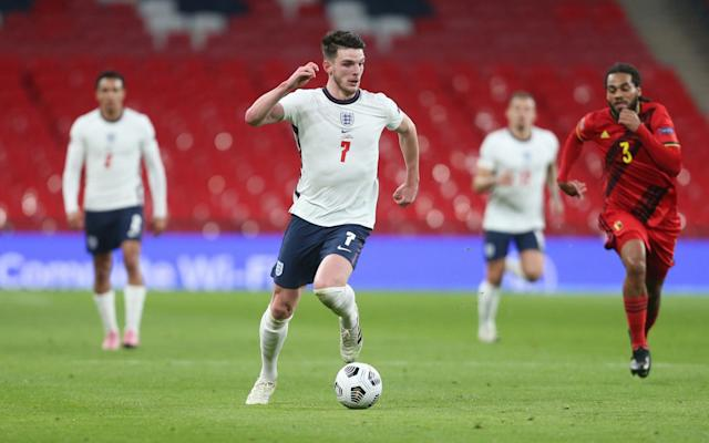 Declan Rice dribbling with the ball in England's win - GETTY IMAGES