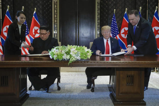 <p>North Korea leader Kim Jong Un and U.S. President Donald Trump prepare to sign a document at the Capella resort on Sentosa Island Tuesday, June 12, 2018 in Singapore. (AP Photo/Evan Vucci) </p>
