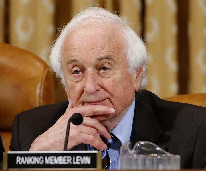 "Rep. Sander Levin, D-Mich., ranking Democrat on the House Ways and Means Committee listens on Capitol Hill in Washington, Friday, May 17, 2013. Political scandals have strange ways of causing collateral damage, and Republicans are hoping the furor over federal tax enforcers singling out conservative groups will ensnare their biggest target: President Barack Obama's health care law. But no one appears to have connected the factual dots yet, and it's unclear whether they will. Levin, the ranking Democrat on the Ways and Means Committee, which oversees the IRS says ""There really isn't a tie,This is another effort by the Republicans to essentially try to score political points."" (AP Photo/Charles Dharapak)"