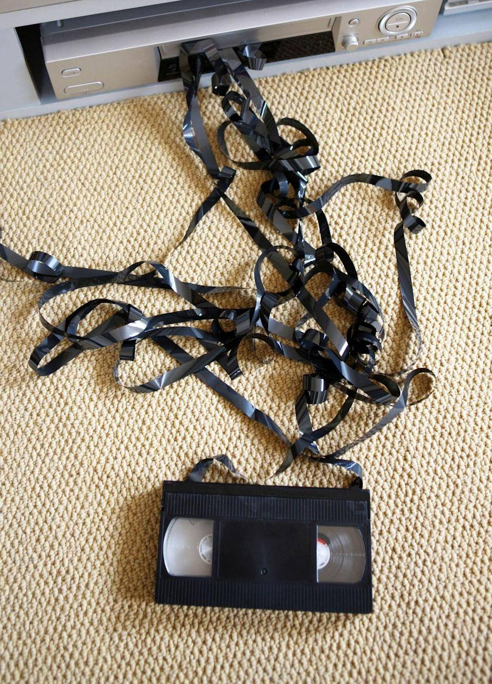 <p>The black boxes you played in your VCR (another mystery to kids these days) were kind of clunky and you had to <em>rewind</em> them when you were done viewing. But the worst thing ever was when the film was pulled out — if you couldn't wind it back up, the days of watching that film were totally over.</p>
