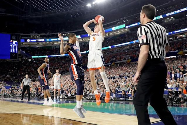 Virginia's Kyle Guy attempts a game-winning 3-point basket as he is fouled by Samir Doughty (10) of the Auburn Tigers in the second half. (Getty)