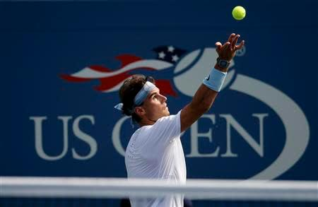 Rafael Nadal of Spain serves to Ivan Dodig of Croatia at the U.S. Open tennis championships in New York August 31, 2013. REUTERS/Ray Stubblebine