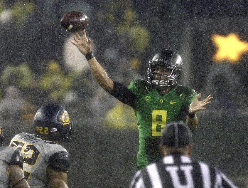 Oregon quarterback Marcus Mariota unleashes a pass during the first half of an NCAA college football game against California in Eugene, Ore., Saturday, Sept. 28, 2013. (AP Photo/Don Ryan)