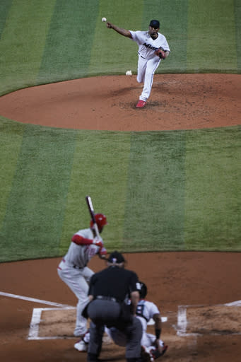 Miami Marlins' Sixto Sanchez, top, pitches to Philadelphia Phillies' Andrew McCutchen during the third inning of the first game of a baseball doubleheader, Sunday, Sept. 13, 2020, in Miami. (AP Photo/Wilfredo Lee)