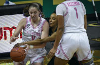 Oregon guard Taylor Mikesell (11) tries to keep control of the ball as Stanford guard Kiana Williams (23) gets a hand on the ball while trying to run through a screen by Oregon forward Nyara Sabally (1) during the first half of an NCAA college basketball game Monday, Feb. 15, 2021, in Eugene, Ore. (AP Photo/Andy Nelson)