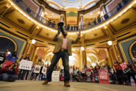 Steve Rowland speaks as protestors gather in the Iowa Capitol rotunda to voice their opposition to mask mandates, Monday, Jan. 11, 2021, at the Statehouse in Des Moines, Iowa. (AP Photo/Charlie Neibergall)