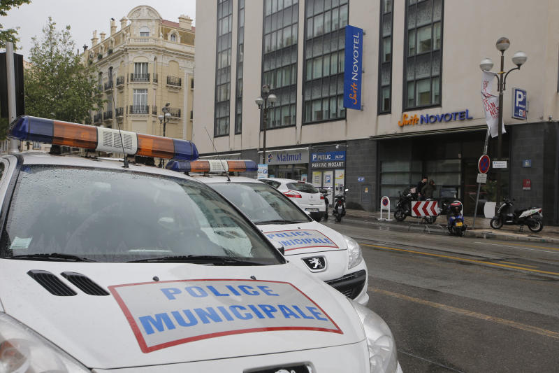 Police cars park outside a hotel during the 66th international film festival, in Cannes, southern France, Friday May 17, 2013. A French police official says a thief or thieves stole about $1 million worth in jewelry inside a safe in a Novotel hotel room, against the backdrop of the Riviera resort town's film festival. (AP Photo/Lionel Cironneau)