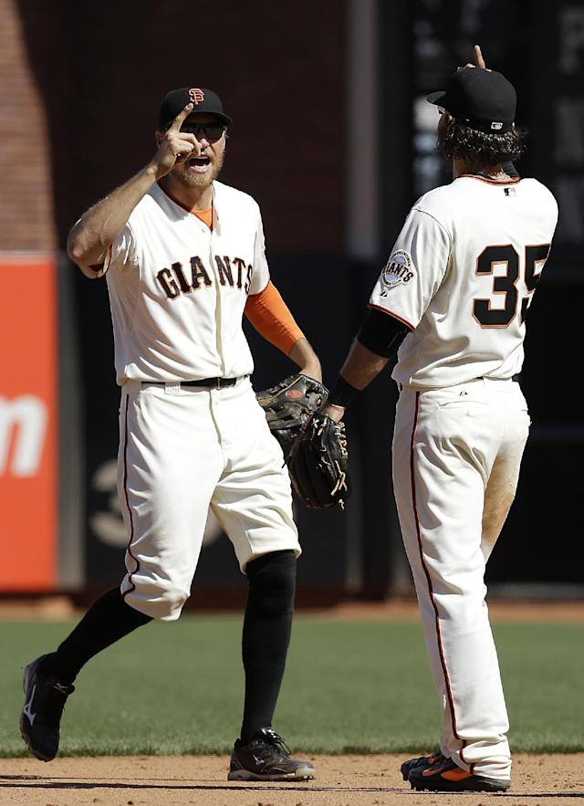 San Francisco Giants right fielder Hunter Pence, left, and shortstop Brandon Crawford (35) celebrate after the Giants defeated the Atlanta Braves 10-4 in a baseball game in San Francisco, Wednesday, May 14, 2014. (AP Photo)