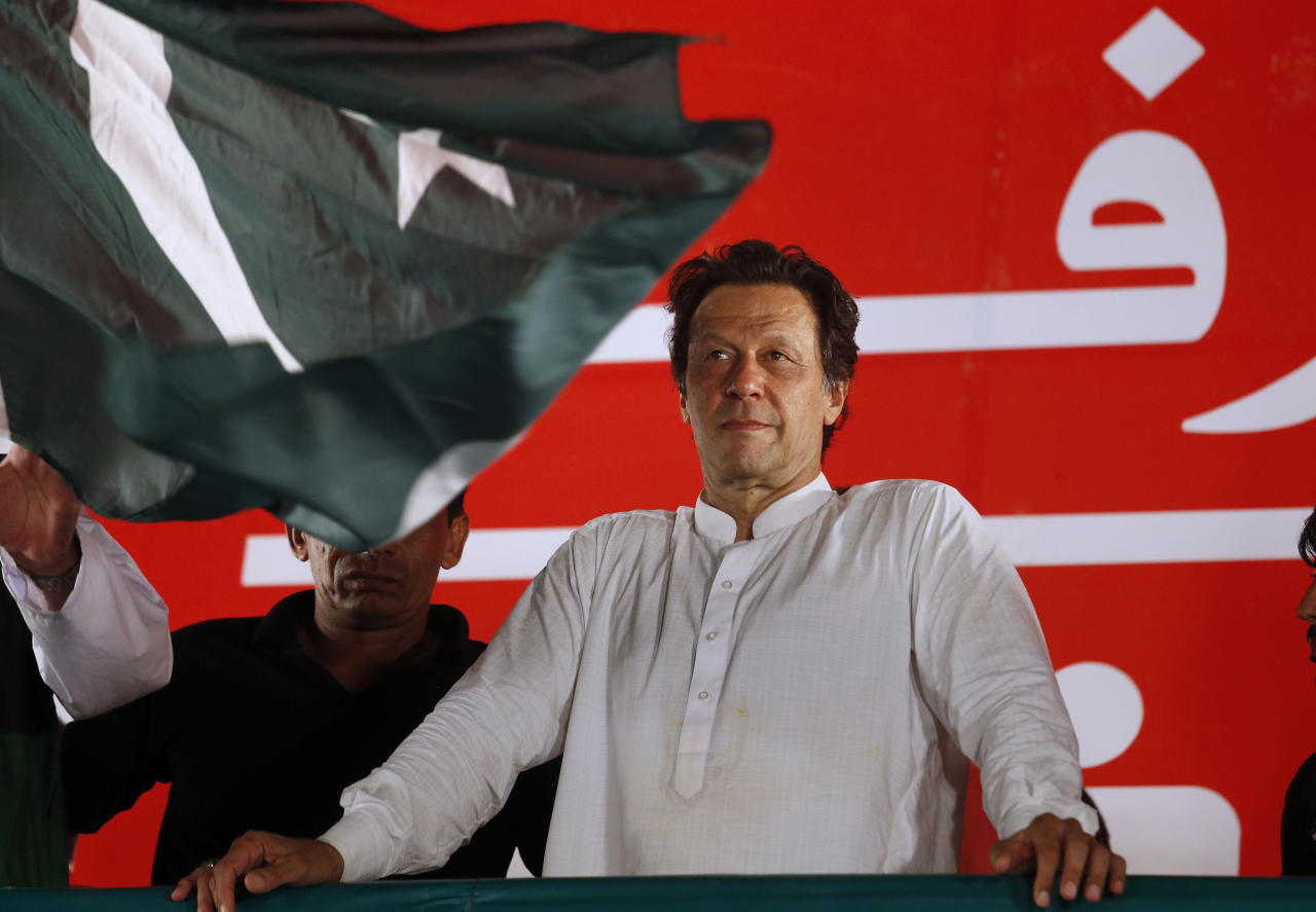"""FILE - In this July 21, 2018, file photo, Pakistani politician Imran Khan, chief of Pakistan Tehreek-e-Insaf party, arrives to address an election campaign rally in Islamabad, Pakistan. The Taliban say they are holding """"another"""" meeting on Monday, Dec. 17, 2018 with U.S. officials, this time in the United Arab Emirates and also involving Saudi, Pakistani and Emirati representatives in the latest attempt to bring a negotiated end to Afghanistan's 17-year war. (AP Photo/Anjum Naveed, File)"""