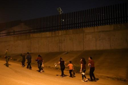 FILE PHOTO: Migrant families turn themselves to U.S. Border Patrol to seek asylum following an illegal crossing of the Rio Grande in Hidalgo