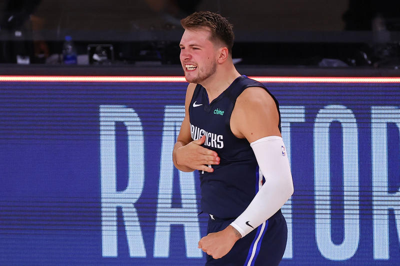 LAKE BUENA VISTA, FLORIDA - AUGUST 23: Luka Doncic #77 of the Dallas Mavericks celebrates a game winning three point basket against the LA Clippers during overtime in Game Four of the Western Conference First Round during the 2020 NBA Playoffs at AdventHealth Arena at ESPN Wide World Of Sports Complex on August 23, 2020 in Lake Buena Vista, Florida. NOTE TO USER: User expressly acknowledges and agrees that, by downloading and or using this photograph, User is consenting to the terms and conditions of the Getty Images License Agreement. (Photo by Kevin C. Cox/Getty Images)