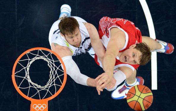 LONDON, ENGLAND - AUGUST 12:  Andres Nocioni (L) of Argentina challenges Timofey Mozgov (R) of Russia during the Men's Basketball bronze medal game between Russia and Argentina on Day 16 of the London 2012 Olympics Games at North Greenwich Arena on August 12, 2012 in London, England.  (Photo by Mark Ralston - IOPP Pool /Getty Images)