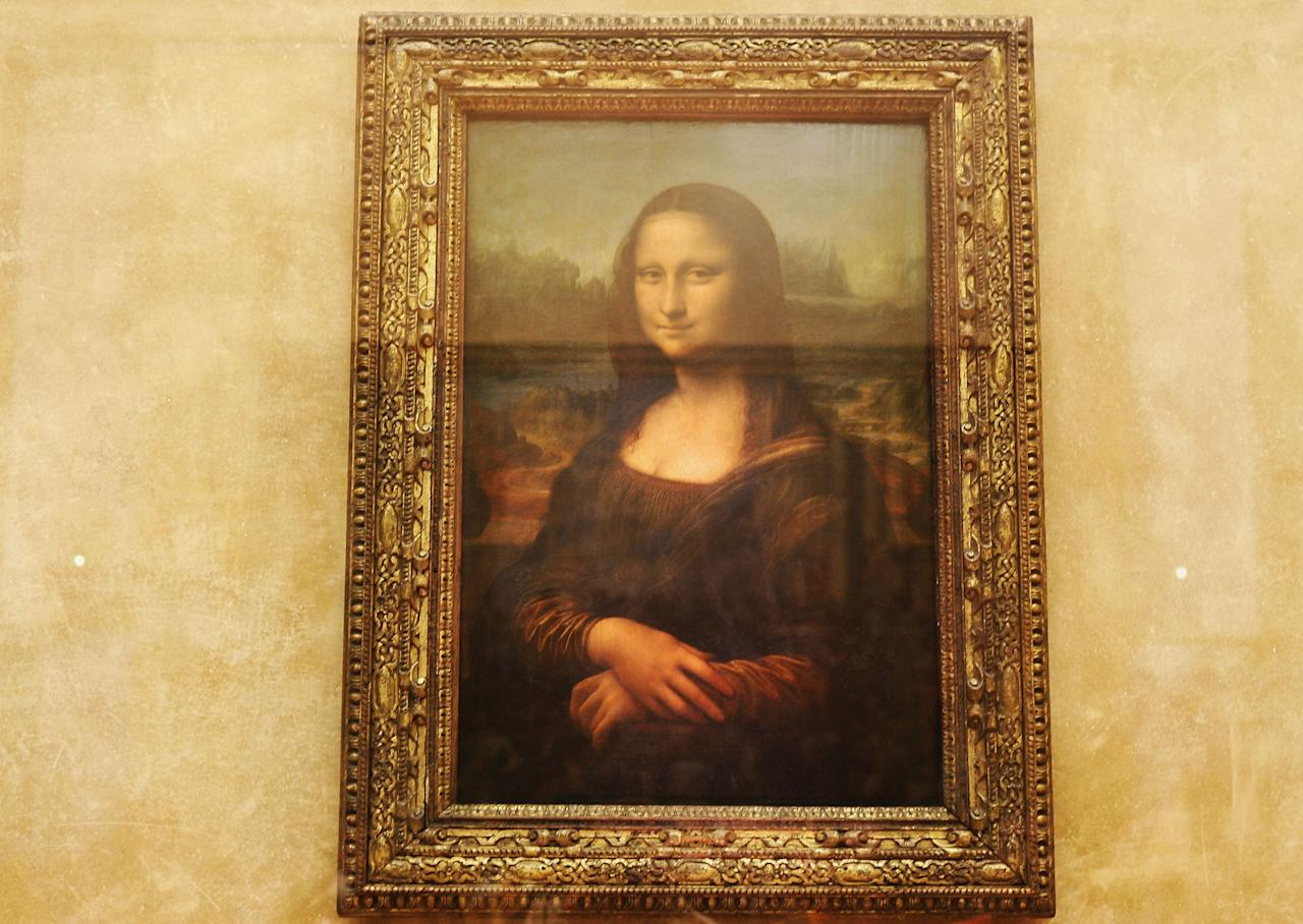 """PARIS - AUGUST 24:    (FILE PHOTO) On Sunday, August 21, 2011 will be 100 Years Since The Theft Of The Mona Lisa From Louvre. On August 21, 1911, Vincenzo Peruggia of Italy stole the painting. It was returned to the Louvre January 1914. Please refer to the following profile on Getty Images Archival for further imagery.  http://www.gettyimages.co.uk/Search/Search.aspx?EventId=109890742&EditorialProduct=Archival  The famous Leonardo Da Vinci painting """" The Mona Lisa"""" is seen on display in the Grande Galerie of the Louvre museum on August 24, 2005 in Paris, France. Dan Brown is the author of numerous  bestsellers, including Digital Fortress, Angels and Demons, and Deception Point. His acclaimed novel """"The Da Vinci Code""""has become one of the most widely read books of all time.  (Photo by Pascal Le Segretain/Getty Images)"""