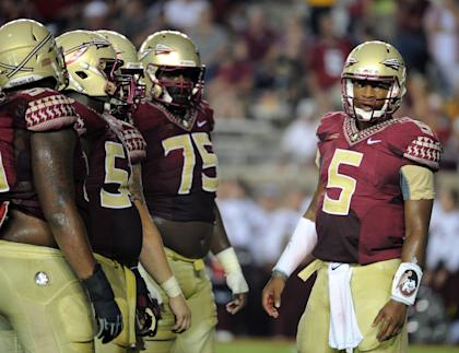 Jameis Winston (5) calls a play in the huddle during FSU's win over Citadel. (USA Today)