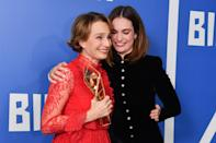 Kristin Scott Thomas with the Richard Harris Lifetime Achievement Award, and presenter Lily James, in the press room during the 22nd British Independent Film Awards held at Old Billingsgate, London.