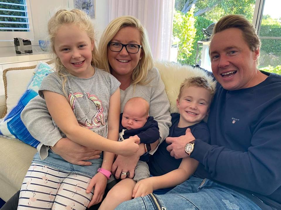 Sam with his wife, daughter, son and newborn.