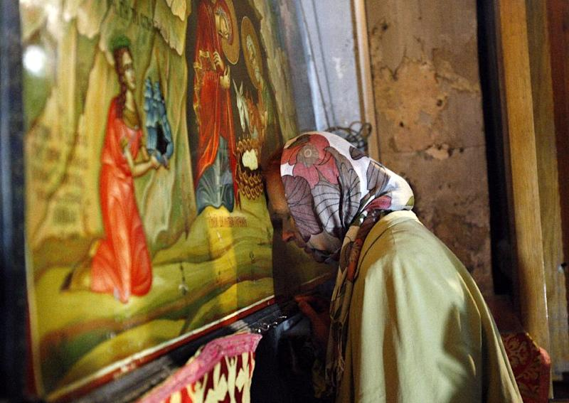 A Catholic pilgrim prays at the Church of Nativity, traditionally believed by Christians to be the birthplace of Jesus Christ, in the West Bank town of Bethlehem, Monday, Dec. 24, 2012. Thousands of Christian worshippers and tourists arrived in Bethlehem on Monday to mark Christmas at the site where many believe Jesus Christ was born. (AP Photo/Adel Hana)