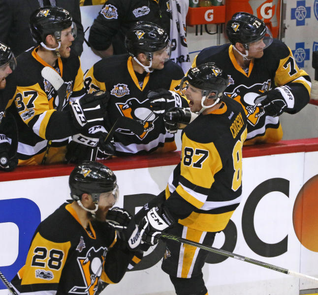 Pittsburgh Penguins' Sidney Crosby (87) celebrates his goal as he returns to the bench during the period third period in Game 5 of an NHL first-round hockey playoff series against the Columbus Blue Jackets in Pittsburgh, Thursday, April 20, 2017. The Penguins won 5-2, to take the best of seven series 4-1. (AP Photo/Gene J. Puskar)
