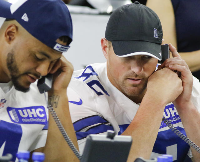 FILE - In this Aug. 31, 2017, file photo, Dallas Cowboys' Dak Prescott, left, and Jason Witten, right, take calls during The Salvation Army telethon at AT&T Stadium in Arlington, Texas. The NFL is planning a telethon to aid coronavirus relief efforts during the draft from April 23-25, 2020, according to two people familiar with the league's plans. The people tell The Associated Press that the league hopes its massive reach will raise awareness and funds in battling the pandemic. They spoke to the AP on condition of anonymity because the telethon has not been announced publicly. (Ron Baselice/The Dallas Morning News via AP, File)