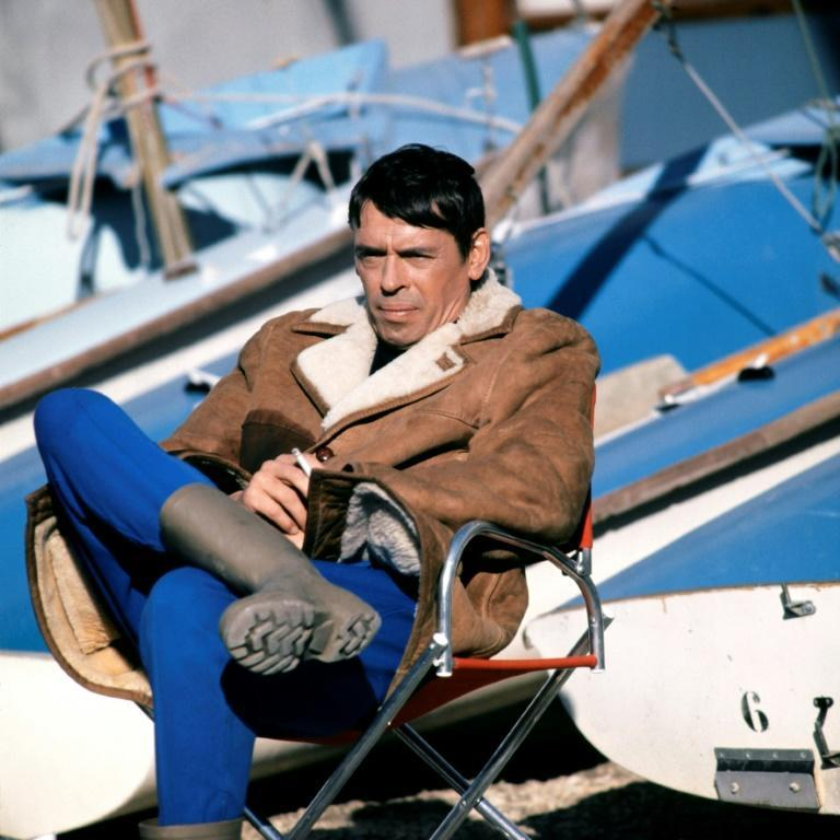Brel sitting at the port of Marseille, southern France, in 1970