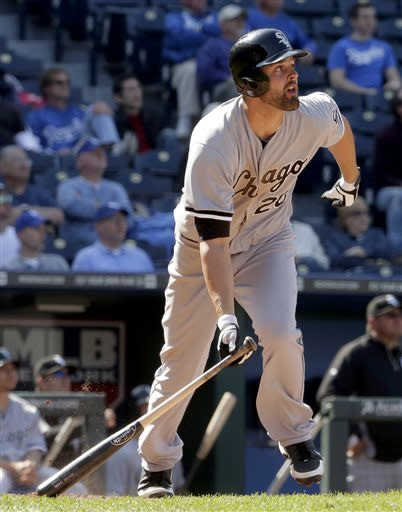 Chicago White Sox's Jordan Danks (20) watches his solo home run during the 11th inning of a baseball game against the Kansas City Royals, Monday, May 6, 2013, in Kansas City, Mo. The White Sox won 2-1. (AP Photo/Charlie Riedel)