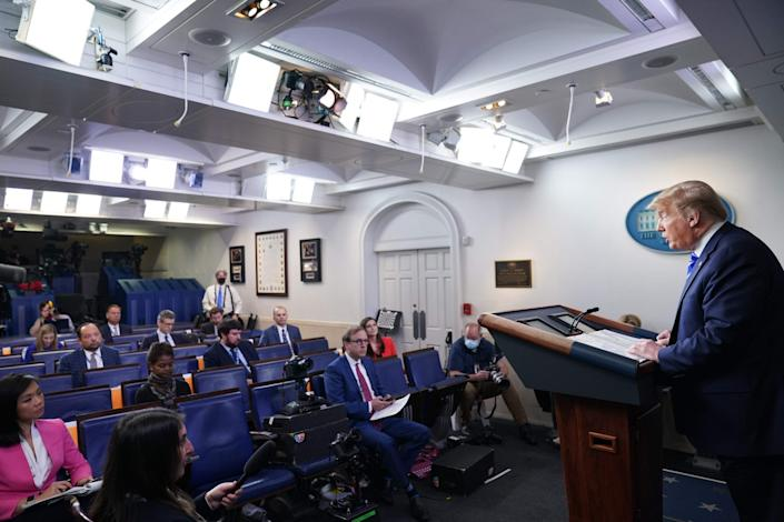 Donald Trump speaks to reporters at a White House briefing on the coronavirus pandemic: AFP/Getty