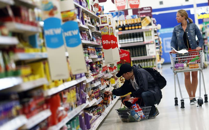 Shoppers browse aisles in a supermarket in London