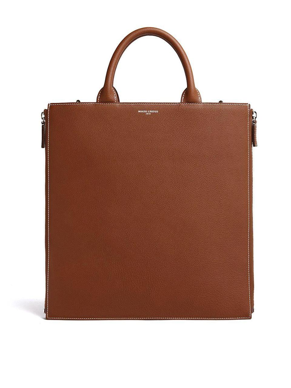 """<p><strong>Mark Cross </strong></p><p>markcross.com</p><p><strong>$1790.00</strong></p><p><a href=""""https://www.markcross.com/products/sidney-leather-tote-bag-tumbled-grain-acorn-palladium?variant=32907099275373"""" rel=""""nofollow noopener"""" target=""""_blank"""" data-ylk=""""slk:Shop Now"""" class=""""link rapid-noclick-resp"""">Shop Now</a></p><p>Chic, elegant, and made with quality leather, this is a work tote that will last a lifetime. Your significant other will want to borrow it for work as well.</p>"""